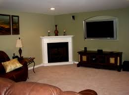 furniture placement in small living room with corner fireplace