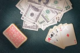 cards on the table poker cards with money on the table stock photo colourbox