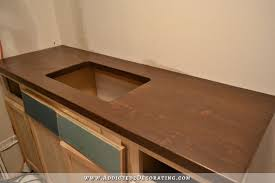 dark stained diy butcherblock countertop with an undermount sink