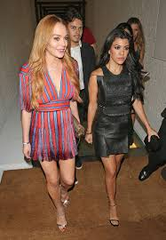 kourtney kardashian and lindsay lohan wear the same dress in the