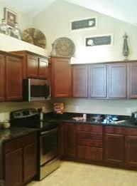 decorating above kitchen cabinets tuscany decor above kitchen