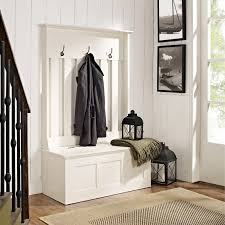 old colored metal entryway storage bencj along with hathooks