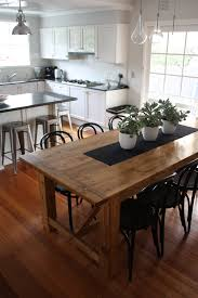 sublime clear varnished wooden industrial dining table with plants sublime clear varnished wooden industrial dining table with plants centerpieces also white kitchen open interior designs