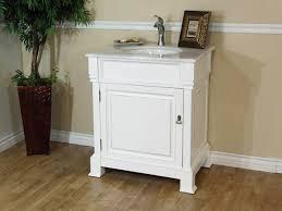 bathroom bathroom vanity lighting with white wood cabinets and bathroom vanity lighting with white wood cabinets and potted plants plus wooden flooring also white baseboard for modern bathroom design ideas