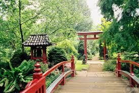 red bridge enterance to small japanese garden stock photo picture