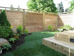 wooden decking for small backyard with bamboo japanese fence