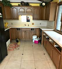 painting kitchen cabinets from white to brown easy painting project for your kitchen cabinets