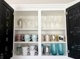 Decorating Ideas For Top Of Kitchen Cabinets by Livelovediy The Chalkboard Paint Kitchen Cabinet Makeover