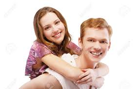 portrait of red haired couple posing on white hugging guy