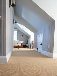 attic area photos hgtv striped attic hallway leads to lounge area loversiq