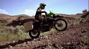 enjoy this touratech equipped kawasaki klr650 playing in the wild