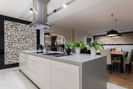 Solid Surface Kitchen Countertops by Gray Solid Surface Countertop On White Island Black Pendant Lights