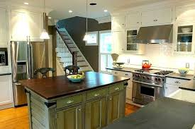 green kitchen cabinets with white island white kitchen cabinets and backsplash with green island wood