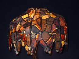 petrified wood table lamp shining light studio