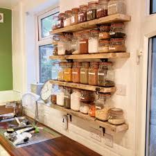 kilner jar storage shelves from old scaffold boards and cast iron