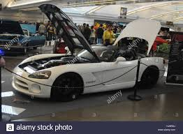a white 2004 dodge viper mamba edition a hard top convertable