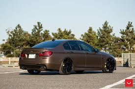 bmw m5 slammed bronze wrapped bmw m5 with carbon fiber bumper lip by vossen