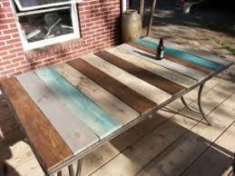 Building Outdoor Furniture What Wood To Use by Patio Table Top Redo With Pallet Wood Kindred Crafty Things