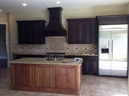 what color countertops go with wood cabinets tired of your kitchen s stale espresso colored cabinets do