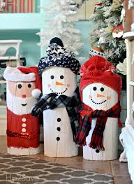diy painted santa and snowman logs painted snowman snowman and logs