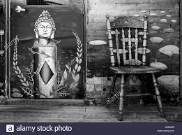 wall mural black and white stock photos images alamy buddha mural next to chair against wall black and white stock image