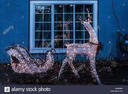 reindeer and sleigh christmas light display stock photo royalty