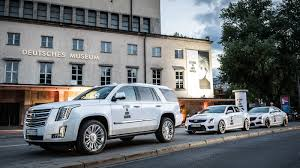 exotic cars lined up cadillac brings pop up lounge and andy warhol exhibition to munich