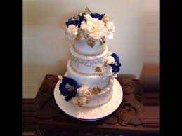 royal blue gold n white 4 tier wedding cake cake by scrumptious