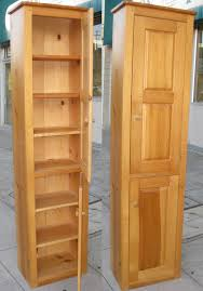Narrow Storage Shelves by Oak Tall Narrow Storage Cabinet With Two Stacked Door And Seven