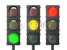 traffic light with yellow and green lights isolated on white