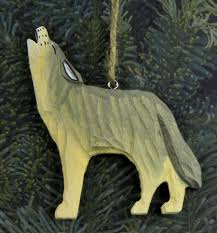 carved wooden howling wolf ornament