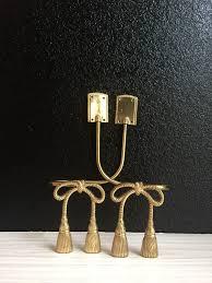 pair regency brass tassel bow tie backs holders