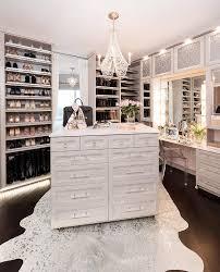glamorous walk in closet features a white metallic cowhide rug