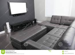 gray and white living room with tv stand and sofa stock photo