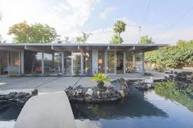 unusual eichler home with glass walls and lava rock pool sells for