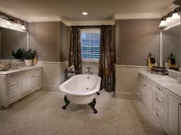 bathroom white clawfoot tub in central with white cabinets and