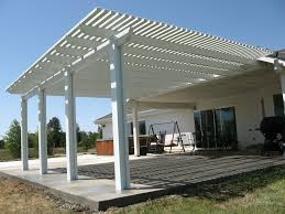 covered patio ideas with rafters and waterproof barrier