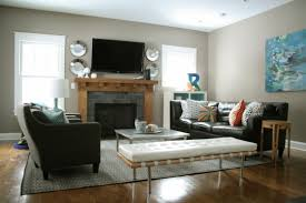gray living room design with fireplace and elegant black leather