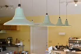Schoolhouse Pendant Lighting by Porcelain Pendants Schoolhouse Light Add Mojo To Coffee House