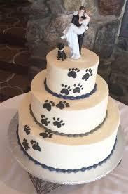 wedding cake topper with dog couples found a way to include their dogs into their wedding and