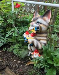 this lawn ornament will keep those pesky garden gnomes away