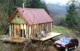 tiny cabin with fold out porch stealth off grid cabin living
