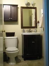 bathroom small dark brown wooden cabinet with double doors also