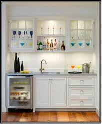 Wet Bar Makeover White And Gray Dining Room Wet Bar Boasts A Stainless Steel Glass