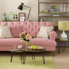 circle wood coffee table living room pink fabric tufted sofa throw pillows circle wood
