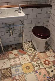 cheap bathroom flooring ideas small bathroom flooring ideas with mixed antique tiles decorating