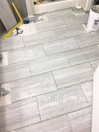 Tile Floor In Bathroom How To Tile A Bathroom Floor With 12x24 Gray Tiles Hometalk