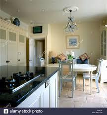 kitchen dining island island unit with gas hob set into granite worktop in kitchen