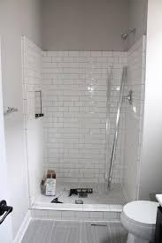 subway tiles bathroom grey glossy subway tiles with timber floor