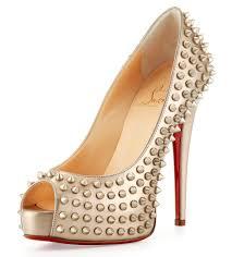 gold heels with spikes is heel